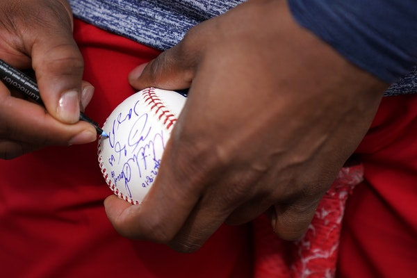 Minnesota Twins shortstop Jorge Polanco (11) signed autographs for fans after an informal workout Tuesday morning.