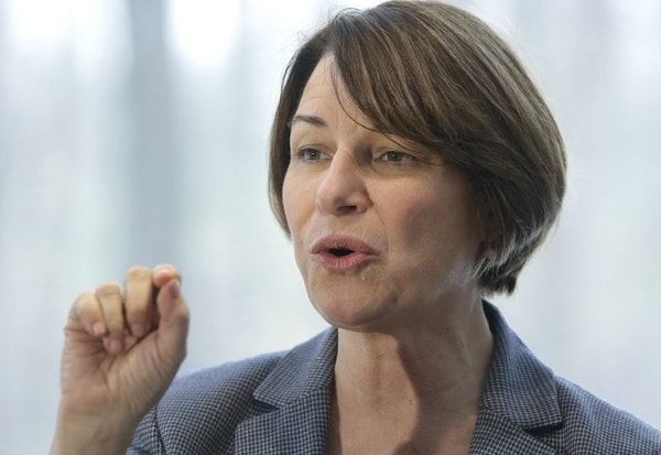 U.S. Sen. Amy Klobuchar has seen some criticism of her tough record as a Hennepin County prosecutor. Above: Klobuchar spoke to voters at a campaign st
