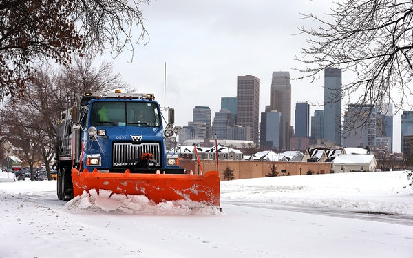 City of Minneapolis plow clears snow from a Olson Highway Service Road in Minneapolis.