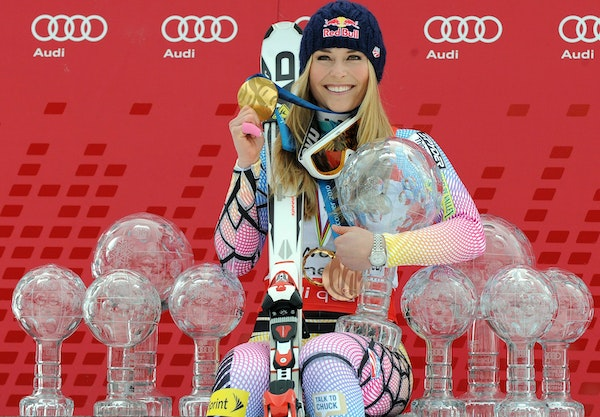 Lindsey Vonn poses in 2010 with Olympic medals and Women's World Cup skiing trophies