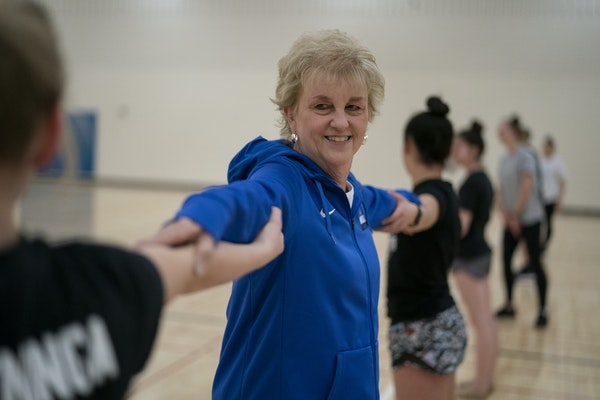 Wayzata coach Leslie Swiggum joined in with her dance team at a recent practice at the high school.