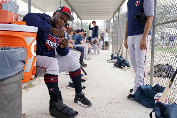 Miguel Sano has worn a boot on his right foot since the Twins started full squad workouts in spring training.