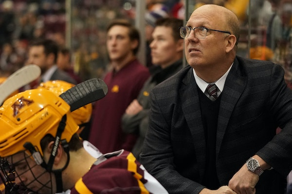 Gophers coach Bob Motzko watched from the bench during a game last month. Minnesota lost Friday night, 3-2 to Notre Dame.