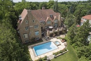 This 1930s stone mansion in Minneapolis comes with a saltwater pool.