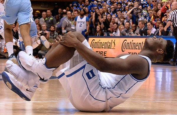 After Duke's Zion Williamson ripped through his shoe and sprained his knee, the debate began: When he recovers, should he focus on Final Four or NBA