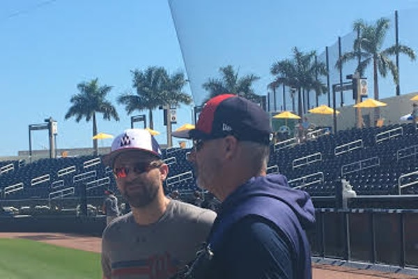 Brian Dozier greets his former teammates, but he won't play today