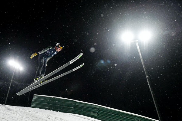 Finn Cherveny, 13, of Minneapolis, practiced his ski jumping Tuesday night in Bloomington on the 25-meter jump. Cherveny has been ski jumping for two