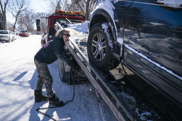 Kerry Brendmoen of Corky's Towing towed a car during a snow emergency in Minneapolis.