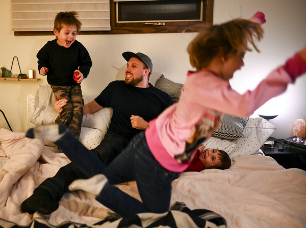 """A beatmaker taking a (pillow) beating: Aaron """"Lazerbeak"""" Mader played with his three children, twin brothers Lou, left, and Cam, both 4, and daughter"""