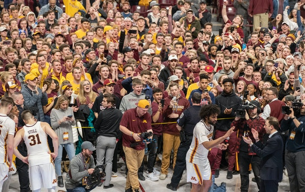 Gophers forward Jordan Murphy thanked the fans who had rushed the court after the Gophers beat No. 11 Purdue.