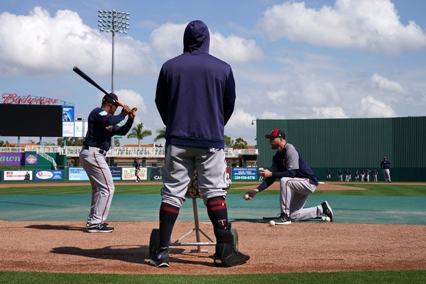 Twins third baseman Miguel Sano has a protective boot on his right leg to protect a cut he sustained in the offseason