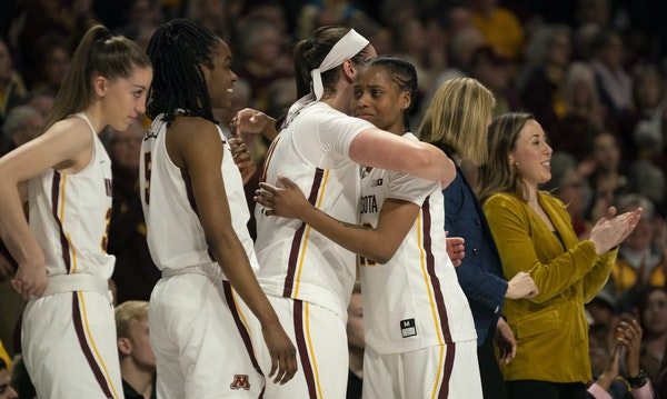 Minnesota Golden Gophers guard Kenisha Bell (23) was hugged by Annalese Lamke (41) as they celebrated a victory over Michigan State earlier this month