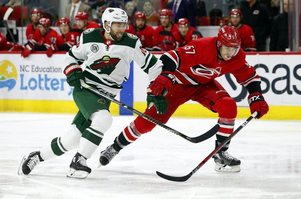 The Wild's Jason Zucker chipped the puck ahead, creating a race with Carolina's Trevor van Riemsdyk in the first period Saturday. The game was in