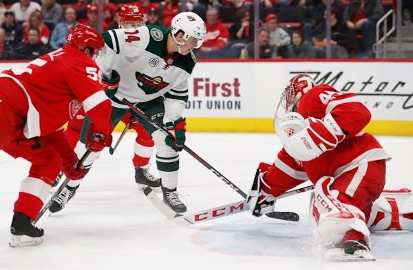 Detroit Red Wings goaltender Jonathan Bernier deflects a shot by Wild center Joel Eriksson Ek during the second period