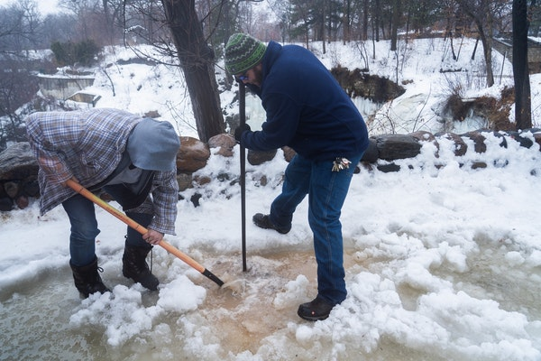 Working from memory and armed with shovels and picks, Minneapolis park keepers Jennifer Dennis and Ryan Susag have been working to clear drains packed