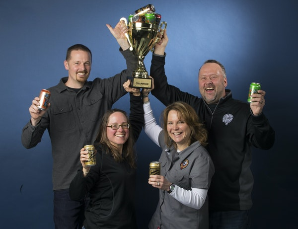 Castle Danger Brewery owners, from left, Clint MacFarlane, Jamie MacFarlane, Mandy Larson and Lon Larson hoisted the trophy after their surprise victo