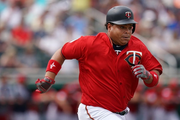 Minnesota Twins catcher Willians Astudillo sprinted down the first base line after he connected with the ball during Monday's game against the Baltimo