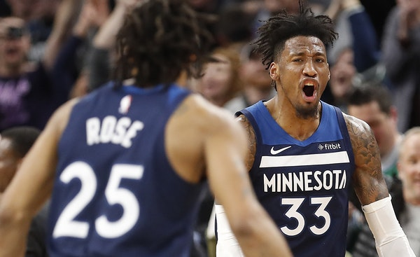 Minnesota Timberwolves forward Robert Covington (33) and Derrick Rose are done for the season.