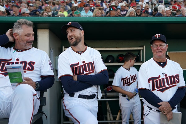Twins manager Rocco Baldelli, center, joked with bench coach Derek Shelton last month. The duo worked together in the Rays organization.