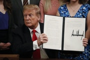 President Donald Trump held up an executive order he signed Thursday requiring colleges to certify that their policies support free speech as a condit