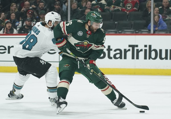 The Wild's Jason Zucker, shown above fighting for the puck with San Jose's Brent Burns, says he thinks it's great that the Wild will finish the