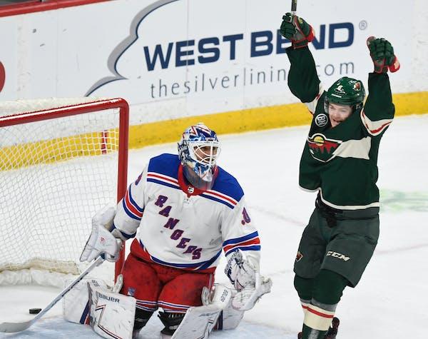 The Wild's Ryan Donato celebrates his second goal in front of New York Rangers goalie Henrik Lundqvist