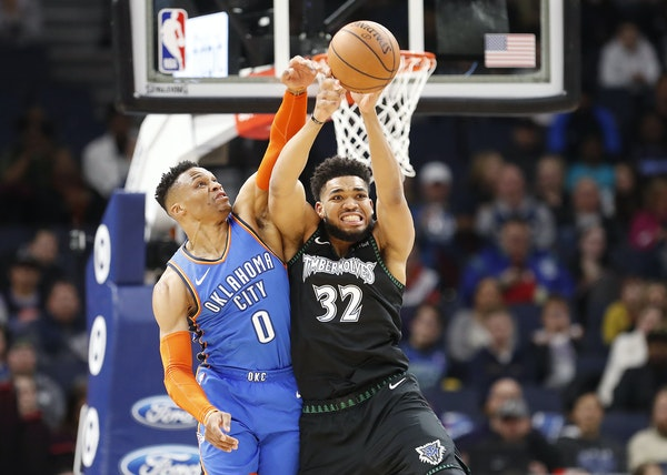 Wolves center Karl-Anthony Towns and Thunder guard Russell Westbrook battled for the ball in the first half Tuesday night.