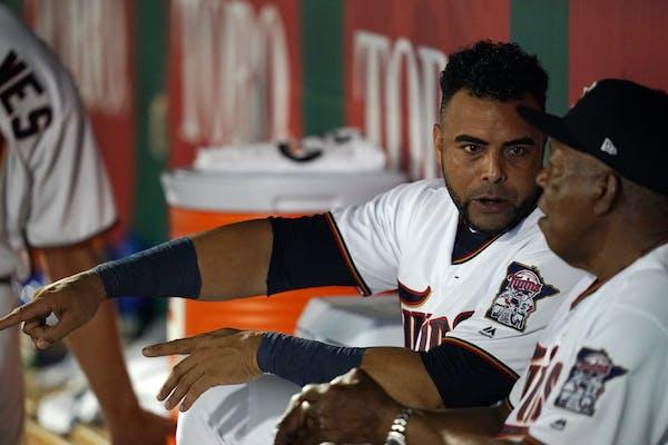 Twins designated hitter Nelson Cruz talked with Tony Oliva last month in Florida.