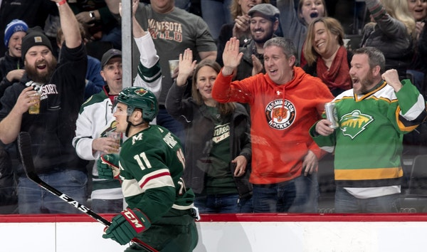 Fans celebrated after Zach Parise scored his second goal of the first period. But things turned bleak later when players and fans saw the Wild was eli
