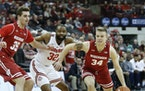 Wisconsin guard Brad Davison, right, and forward Nate Reuvers are key for the Badgers.