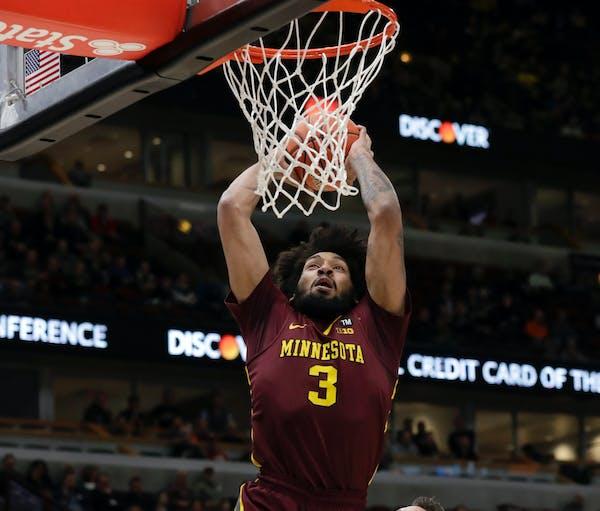 Jordan Murphy goes up for a dunk against Purdue's Grady Eifert