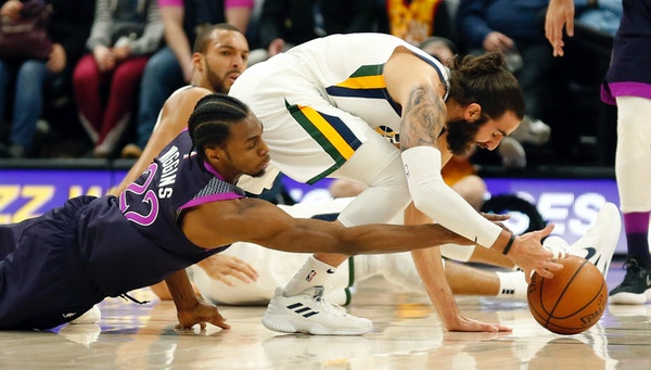 Timberwolves forward Andrew Wiggins battled with Jazz guard Ricky Rubio