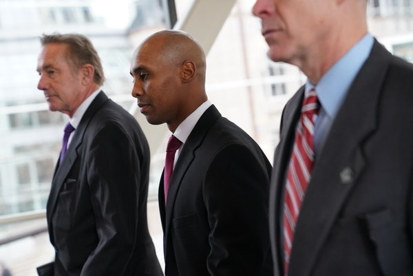 Mohamed Noor, accompanied by his legal team, headed into court last week for the beginning of a trial on murder charges for killing Justine Ruszczyk D