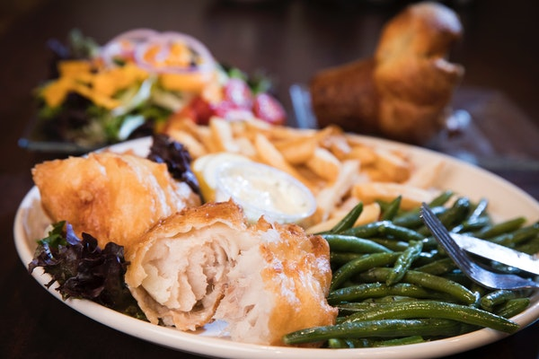The Little Oven's fish fry dinner with green beans, french fries, salad and a popover.