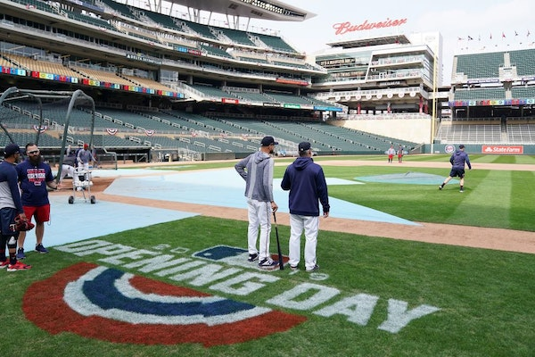 Minnesota Twins manager Rocco Baldelli (5) and bench coach Derek Shelton watched workouts Wednesday.