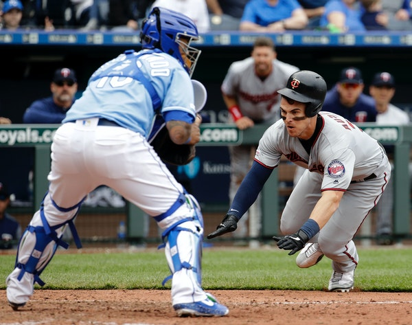 The Twins' Tyler Austin beats the tag at home by Royals catcher Martin Maldonado to score on a single by Max Kepler during the eighth inning