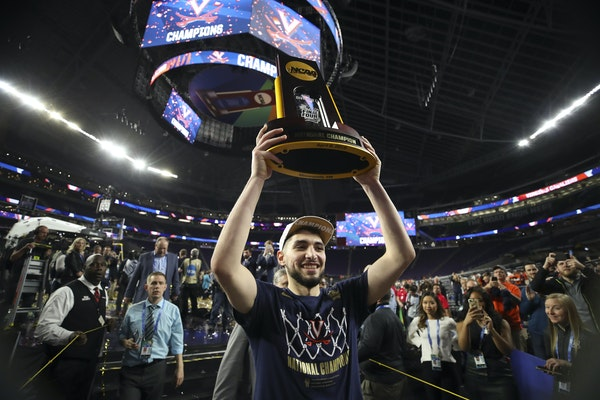 Virginia's Ty Jerome hoisted the championship trophy aloft Monday as he walked off the U.S. Bank Stadium court. The Cavaliers showed that not just t