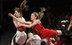 As Minnehaha Academy guard Taytum Rhoades (0) drove to the basket, she ran into Caledonia guards Katie Tornstrom (23) and Kaitlin Conniff (12) in the