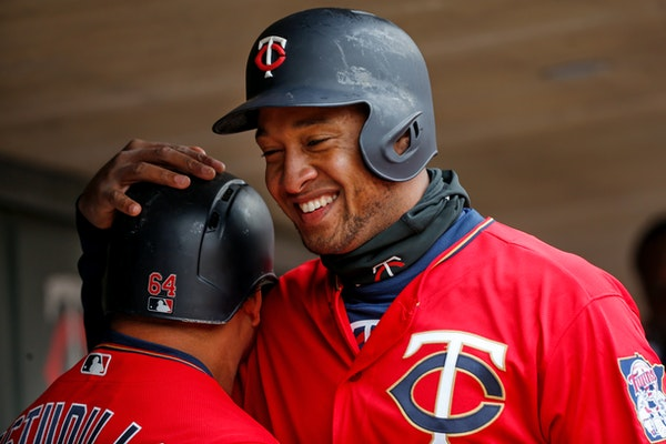 The Twins' Willians Astudillo and Jonathan Schoop, right, celebrate their runs against the Indians in the fourth inning