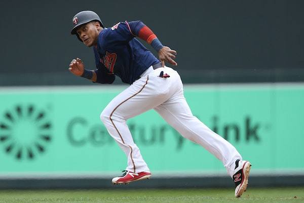 The Twins' Jorge Polanco tries to steal second base against the Tigers on Saturday.