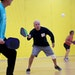 The Burnsville Community Center was brimming with pickleball games Thursday, including the one with Darrell Goring, who returned a shot as Bill Gustaf