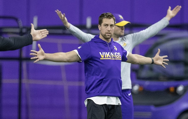 Vikings wide receiver Adam Thielen stretched before practice on Tuesday.