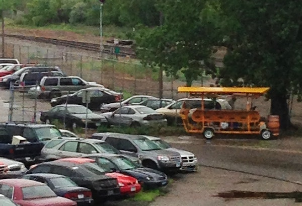 A pedal pub sits amid other vehicles at the Minneapolis impound lot.