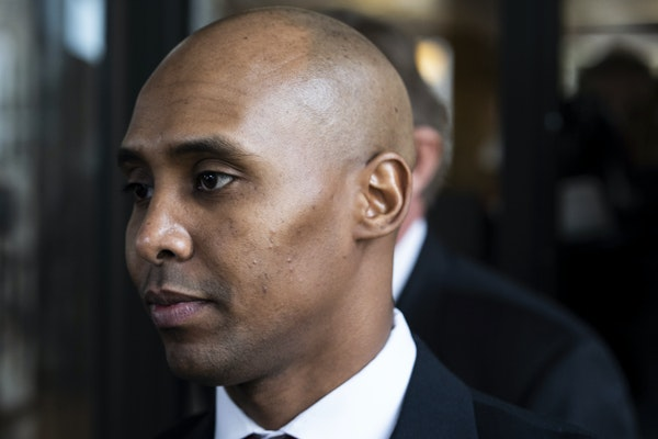 Former Minneapolis police officer Mohamed Noor leaves the Hennepin County Government Center after the first day of trial in Minneapolis on Monday, Apr