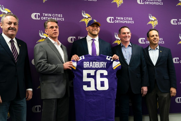 Vikings first-round pick Garrett Bradbury held his jersey with, from left, owner Zigi Wilf, general manager Rick Spielman, head coach Mike Zimmer, and