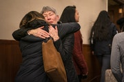 Linda Thompson, the former administrative assistant in the dental hygiene program at Argosy University, hugs a student after the hearing.