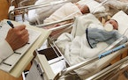 FILE - This Feb. 16, 2017 file photo shows newborn babies in the nursery of a postpartum recovery center in upstate New York. According to a governmen