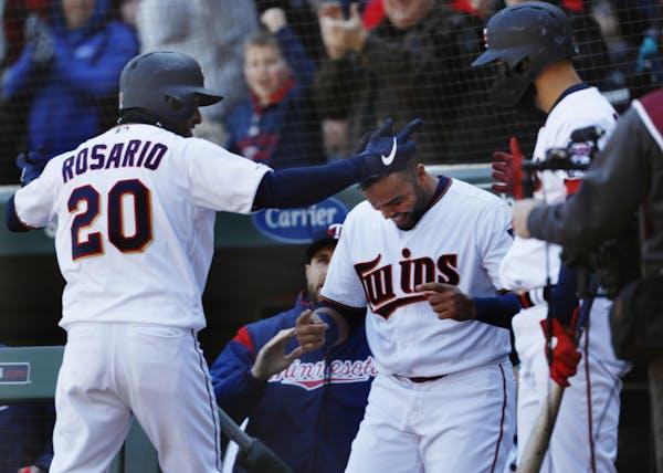 Eddie Rosario (20) celebrates his home run in the seventh inning.