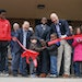 Mayor Melvin Carter called on all the neighborhood kids at the grand opening to cut the big ribbon with the big scissors. On the left, Senator Foung H