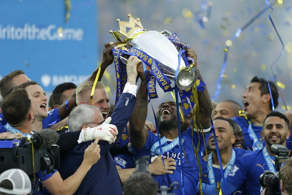 Leicester's Wes Morgan lifted the trophy as Leicester City celebrated becoming the English Premier League soccer champions on May 7, 2016 at King Po